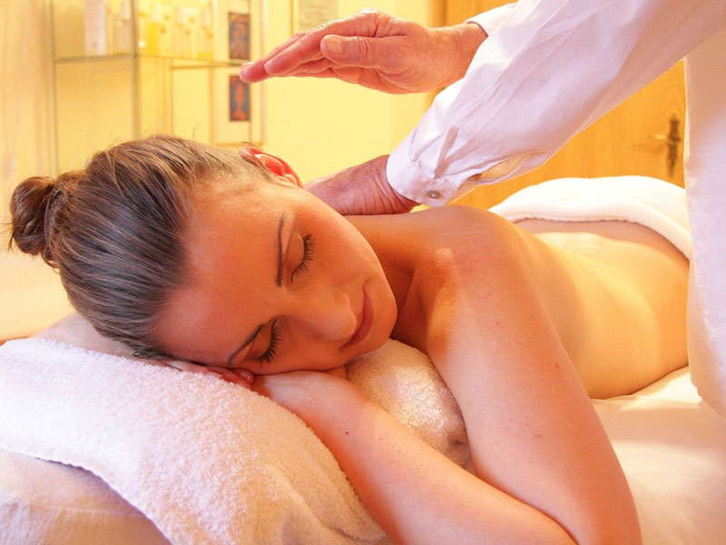 woman relaxing and getting back massage
