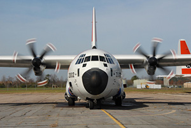 front of coast guard airplane with propellers spinning