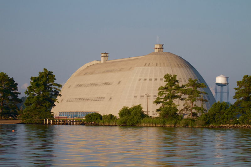 view of tcom blimp base from across river