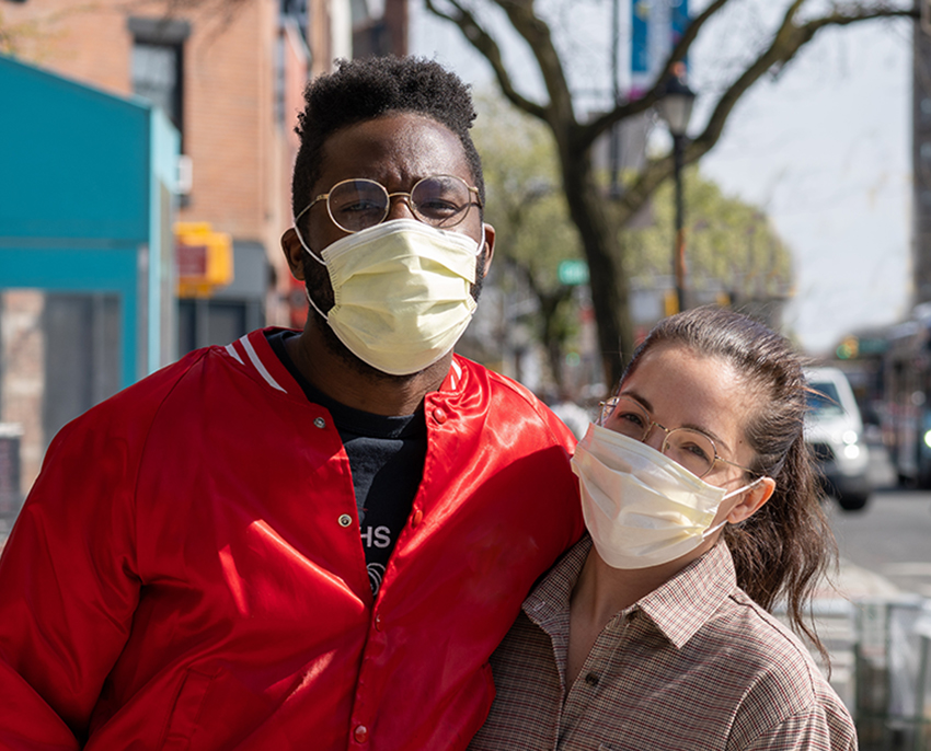 couple downtown wearing facemasks